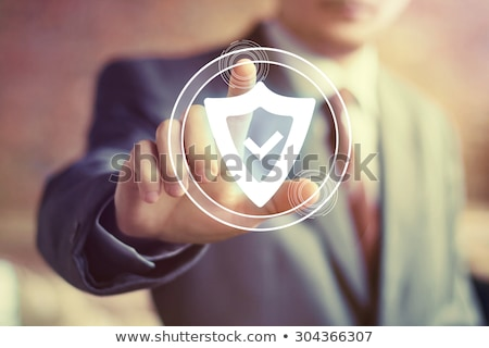 security shield as symbol of financial safety Stock photo © LoopAll