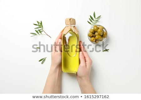 a glass jar with olive oil stock photo © marimorena