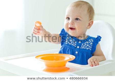 Sevimli küçük bebek oturma yeme gıda Stok fotoğraf © anbuch