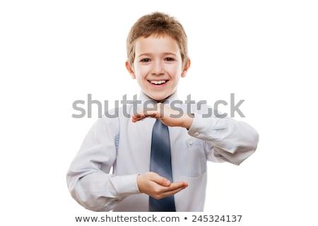 Mosolyog gyermek fiú kéz tart láthatatlan Stock fotó © ia_64