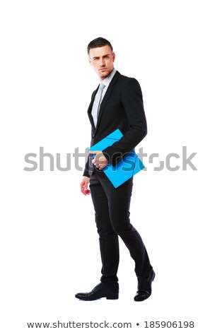Full-length portrait od a businessman standing with blue folder over white background Stock photo © deandrobot