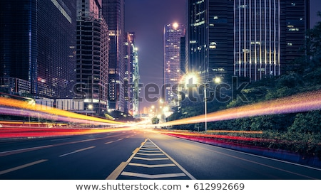 Stock photo: car light trails on a busy motorway at dusk