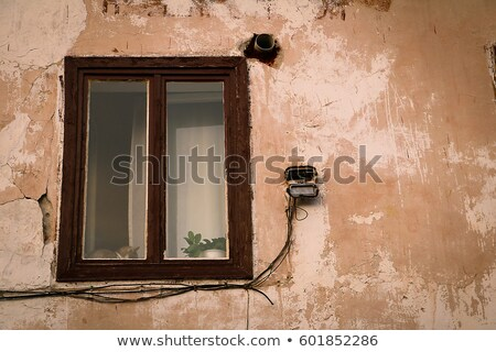 Stockfoto: Old Windows On Ruined House Exterior Wall