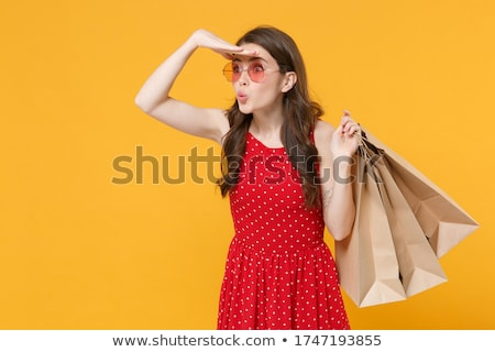 Woman in polka-dot dress isolated on white Stock photo © Elnur