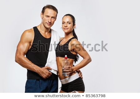 sport couple   man and woman after fitness exercise on the white stock photo © vlad_star