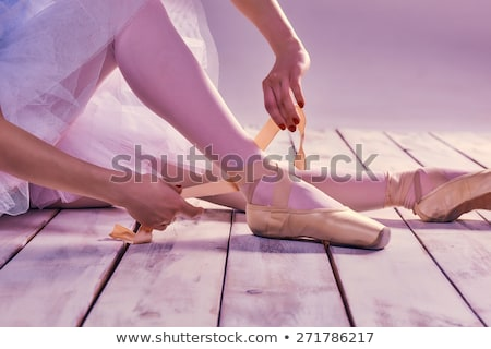 young ballerina putting on her ballet shoes stock photo © master1305