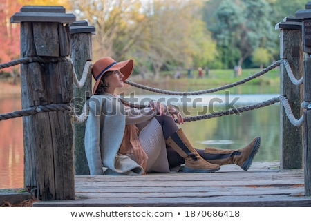 Alone Young Woman at the Edge of Wooden Pier Stock photo © stevanovicigor