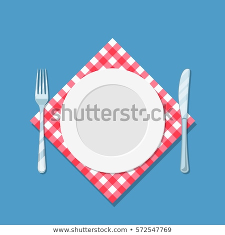 white plate on a red cloth isolated on white stock photo © tetkoren