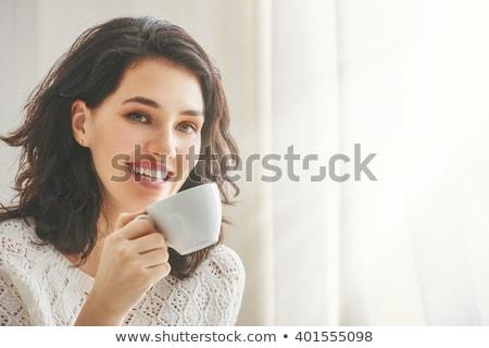 женщину питьевой кофе кровать домой портрет Сток-фото © deandrobot