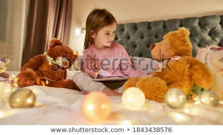 boy and pretty little girl sleeping on bed in cosy room Stock photo © Paha_L