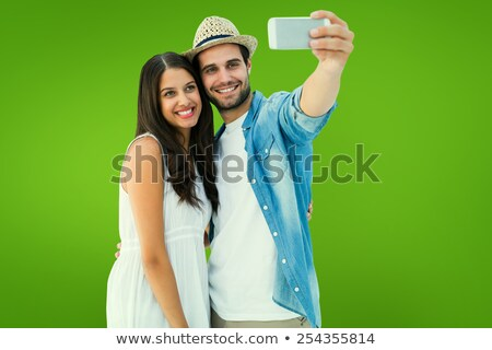 Composite image of smiling couple taking selfie Stock photo © wavebreak_media