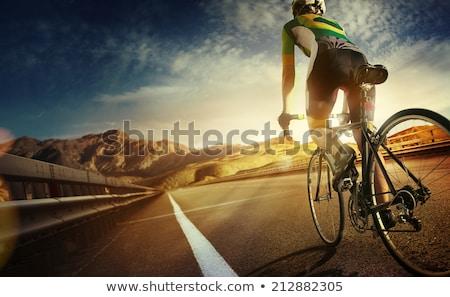 kerékpáros · bicikli · versenypálya · fiatal · sisak · védőszemüveg - stock fotó © kzenon