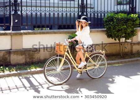 Retro fashion girl riding bike at park on fall day stock photo © cienpies