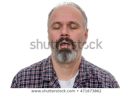 Balding man with beard and plaid shirt snores Stock photo © ozgur