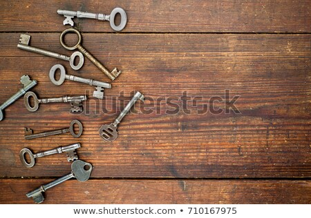 old key on wooden table stock photo © fuzzbones0