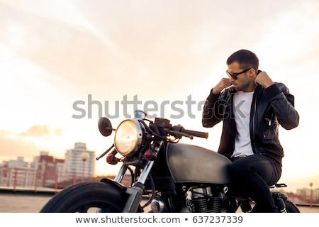 Stock photo: Man on the black motorbike