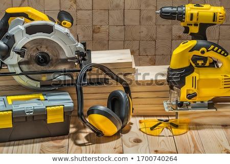 Elektryczne widział człowiek pracy domu drewna Zdjęcia stock © racoolstudio