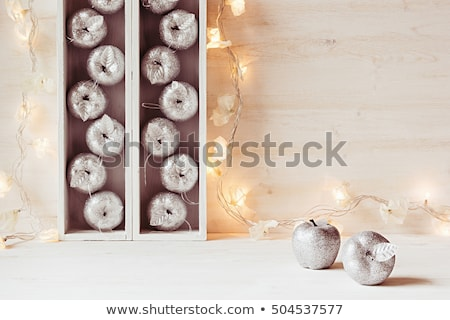 Zdjęcia stock: Christmas Silver Apples And Lights Burning In Boxes On A Wooden White Background