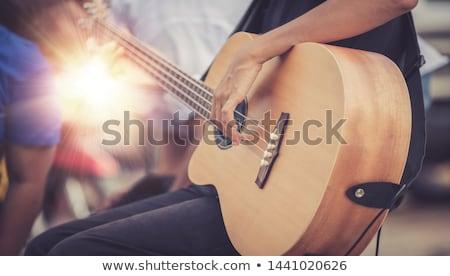 fiatalember · játszik · elektromos · gitár · színpad · fotó · hosszú · haj - stock fotó © sumners