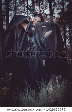Mystery woman with hand near face looking away Stock photo © deandrobot