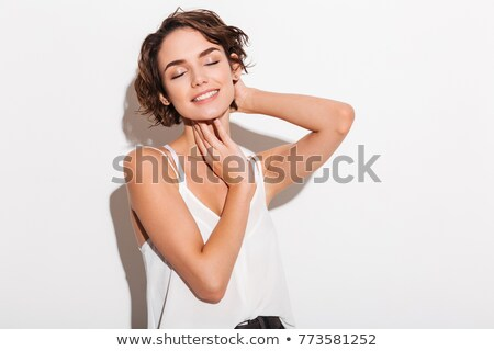 Incredible lady posing with eyes closed. Stock photo © deandrobot