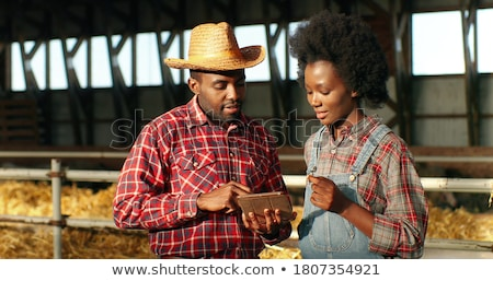 Friendly african-american farmer man. Stock photo © RAStudio