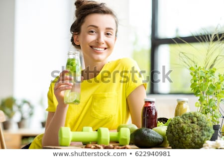 portrait of sitting woman with bottle of water stock photo © phbcz
