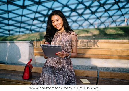 Woman with tablet and Share text with drawings graphics Stock photo © wavebreak_media