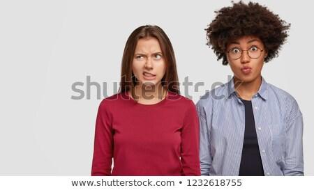 Oldalnézet elégedetlen afrikai nő kettő barátok Stock fotó © deandrobot