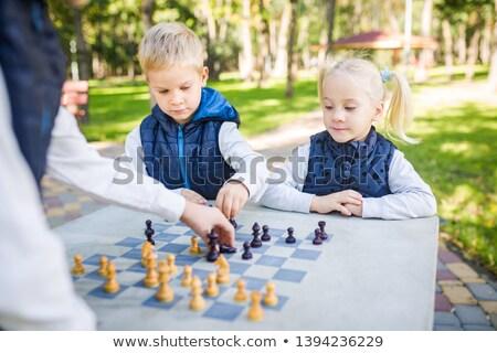 Dziewczyna gry szachy szkoły Zdjęcia stock © wavebreak_media