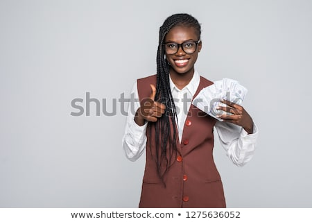 Smiling businesswoman with thumb up sign, isolated on white background Stock photo © Nobilior