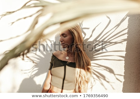 serious young blonde lady outdoors with eyes closed stock photo © deandrobot