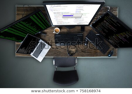 Multiple Computer Screen Showing Progress Bar Of Copying Files Stock photo © AndreyPopov
