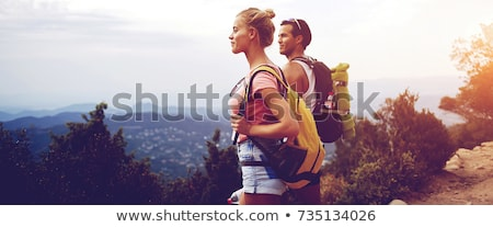man & woman resting on hike Stock photo © IS2