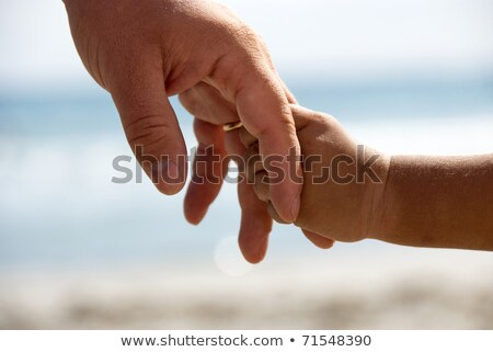 Baby strak hand man zorg Stockfoto © IS2