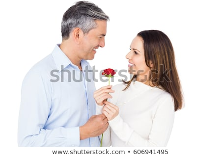 mature man offers rose to mature woman. Stock photo © IS2