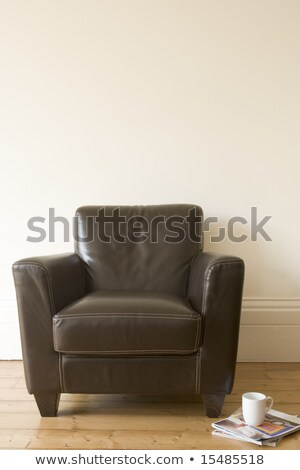 Chair with coffee mug and magazine beside it Stock photo © monkey_business