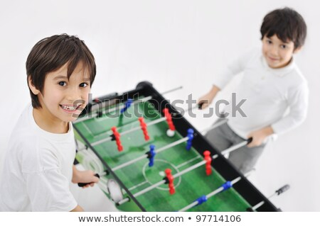 two boys playing table football stock photo © is2