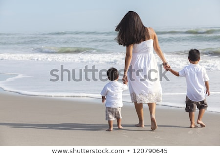 Mother walking with two boys Stock photo © IS2