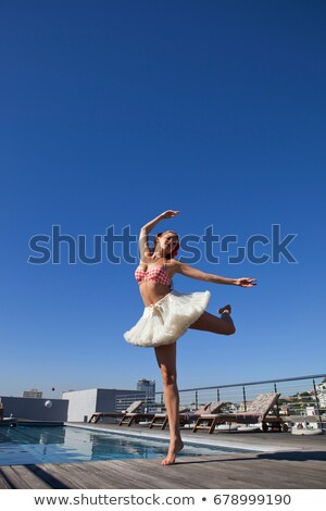 Woman in tutu dancing by pool Stock photo © IS2