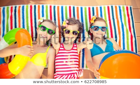 girl with beach ball by swimming pool portrait stock photo © is2