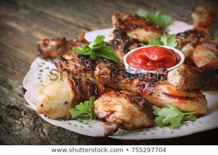 ızgara tavuk bacaklar ahşap masa hizmet beyaz plaka Stok fotoğraf © Virgin