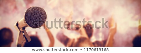 Microphone with stand against fans enjoying with arms raised at nightclub Stock photo © wavebreak_media