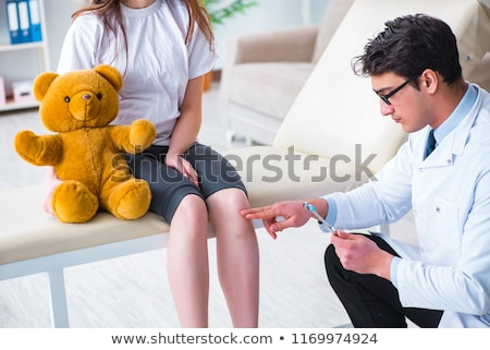 A Girl Checking Reflexes with Doctor Stock photo © bluering