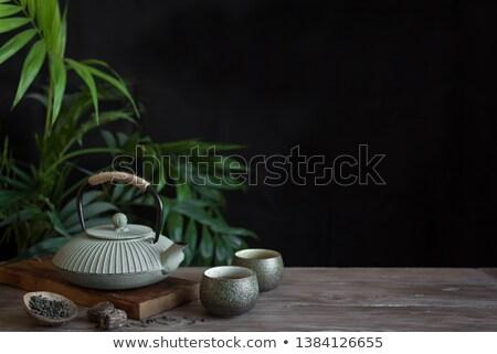Tea set on dark Stock photo © YuliyaGontar