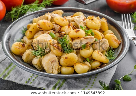 Fried gnocchi chicken curry Stock photo © Peteer