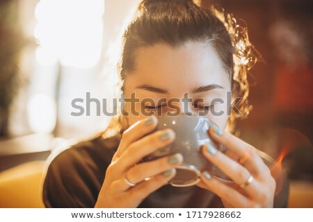 Pretty woman drinking latte Stock photo © Anna_Om