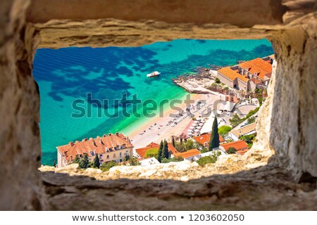 Banje beach in Dubrovnik aerial view through stone window stock photo © xbrchx