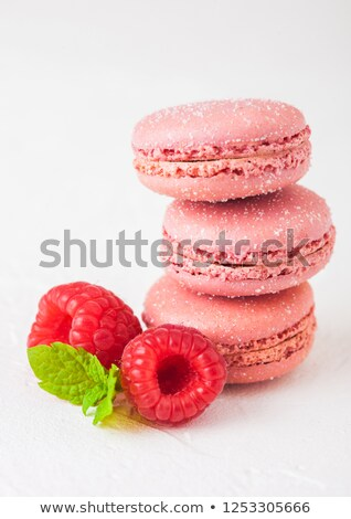 Pink dessert cake macaron or macaroon with raspberry and mint leaf on stone kitchen background.  Stock photo © DenisMArt