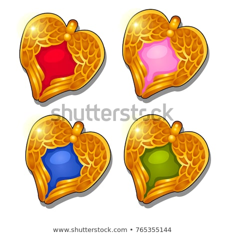 Set of gold pendants in the shape of a heart with textured angel wings isolated on a white backgroun Stock photo © Lady-Luck